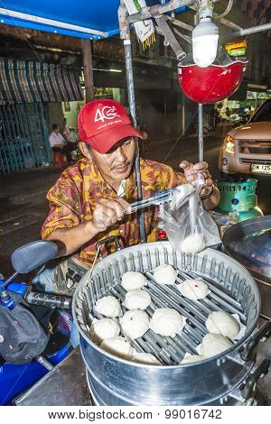 Man Sells Delicious Dumplings At The Outdoor Market