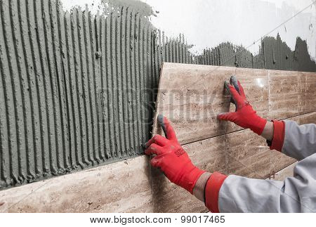 Home Improvement, Renovation - Construction Worker Tiler Is Tiling, Ceramic Tile Wall Adhesive