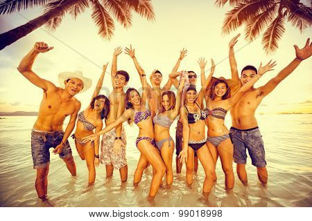 Group of people enjoying on beach party, friends having fun on summer vacation