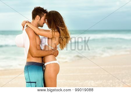 Affectionate couple embracing  on beach