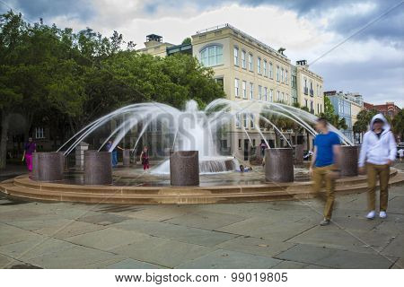 CHARLESTON, SOUTH CAROLINA-MAY 9, 2015: Unidentified people play in and around the famous fountain in downtown Charleston, South Carolina