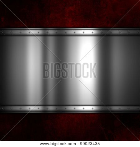 Shiny metal plate on a red grunge background with scratches and stains