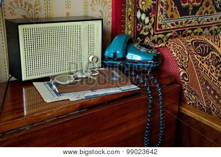 Soviet Retro Radio And Telephone On The Table