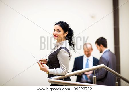 businesswoman holding tablet computer with colleague