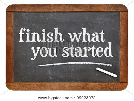 Finish what you started - motivational reminder on a vintage slate blackboard