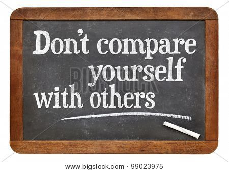 Do not compare yourself with others- motivational advice  on a vintage slate blackboard