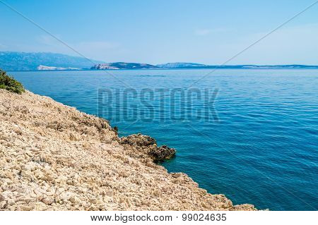 Rocky Coastline With Crystal Clear Blue Adriatic Sea With Islands In The Background