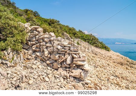 Rocky Coastline With Bushes And Trees And Crystal Clear Blue Adriatic Sea With Islands In The Backgr
