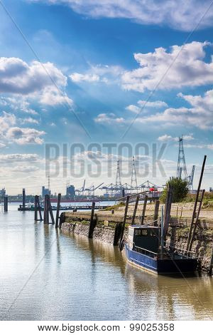 View on the busy port of Antwerp, seen from the little old port of Lillo village