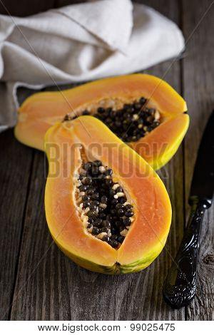Cut papaya on a wooden table