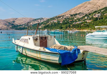 An Old Rusty Fisherman's Boat Tied On The Dock On The Adriatic Sea