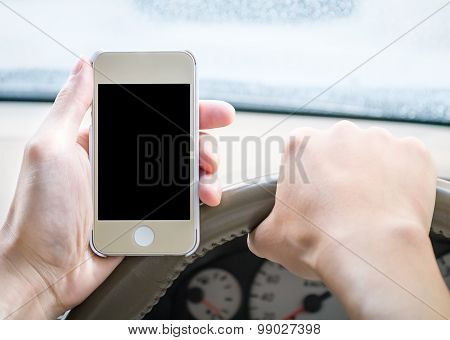 Driver Holding Smartphone In The Car