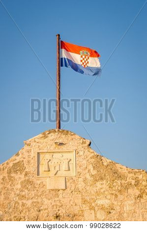 Croatian Flag On The Fortress Wall Above The Ancient Entrance