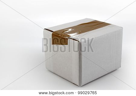 Closed cardboard box on plain background