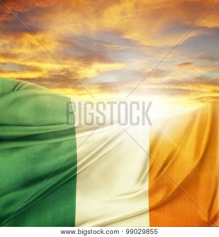 Irish flag in front of bright sky