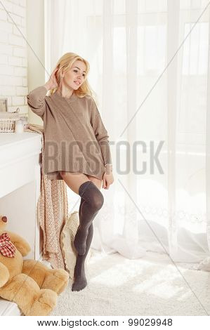 Lovely Girl In Stockings Standing At The Window.