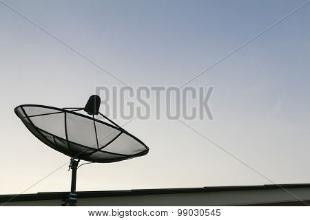 Satellite dish on the roof and sky