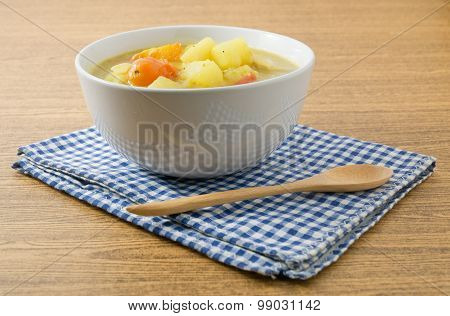 Vegetable Soup With Potato And Tomato In White Bowl