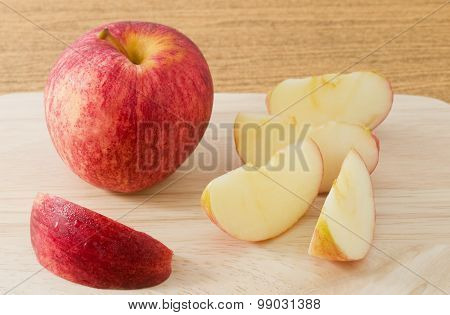 Ripe Red Apple On A Wooden Tray