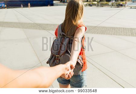 travel, summer vacation, tourism and love concept - close up of couple with backpack in city