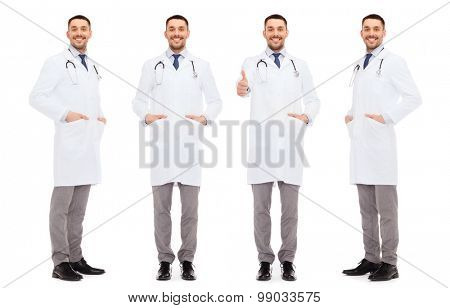 medicine, profession and health care concept - happy doctors with stethoscope showing thumbs up