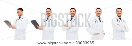 medicine, profession and health care concept - happy doctors with clipboard and stethoscope