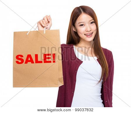 Asian woman take shopping bag and showing a word sale!