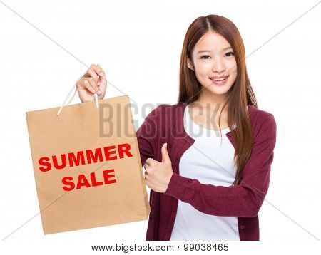 Young Woman hold with shopping bag and thumb up for showing summer sale