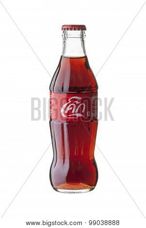BANGKOK THAILAND - JULY 28 2015. Glass Bottle of Coca-Cola on white background. Coca-Cola is produced by The Coca-Cola Company and is often referred to simply as Coke.