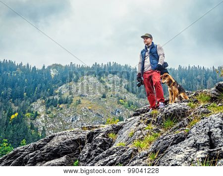 Young man with dog outdoors