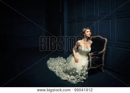 Young beautiful girl in a white dress