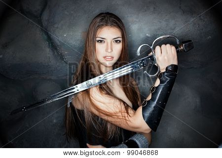 Beautiful Girl Holding A Steel Sword In His Hand.