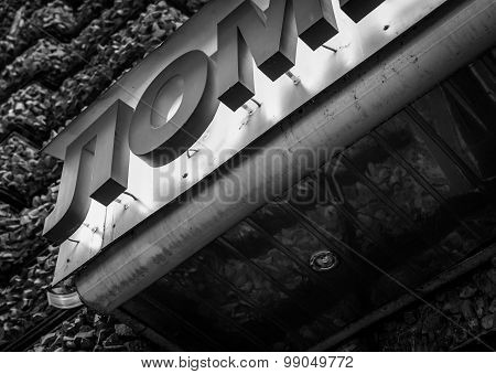 Red Neon Bar Sign In Russian Alphabet Using Black And White