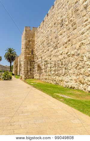 The ancient city walls and towers in the old Jerusalem