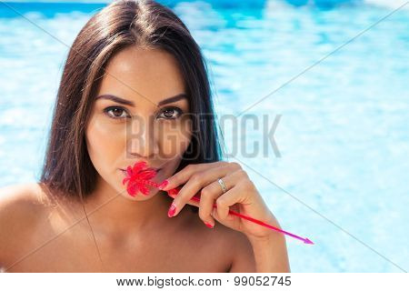 Portrait of a charming woman standing in swim pool