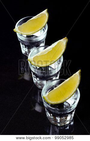 Tequila With Lime On Black Background.