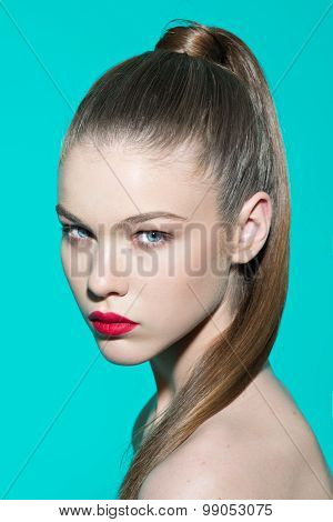 Beauty model portrait woman with fresh makeup and strong hairstyle.