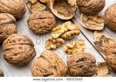 Fresh raw walnuts on wood