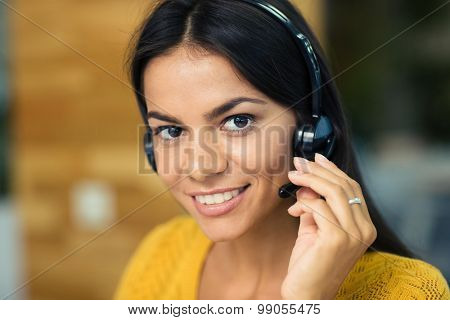 Closeup portrait of a smiling casual businesswoman with headphones