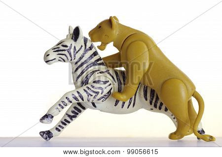 hunting lion on a zebra plastic toy