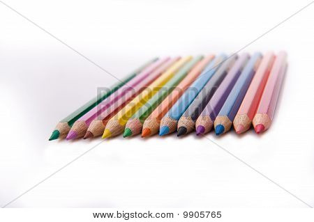 twelve sharpened colored pencils