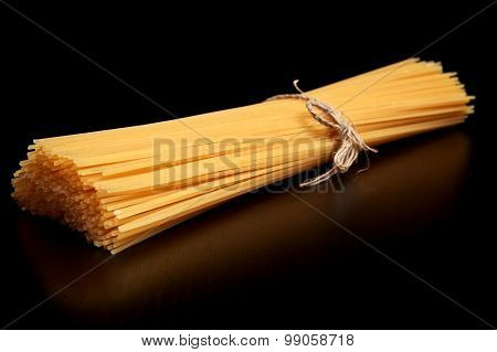 Long Pasta Raw Isolated On Black Table