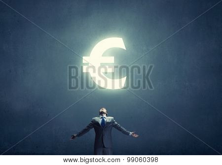 Businessman with hands spread apart and euro sign above