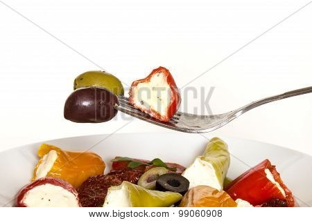 Fork with olives and red chillies