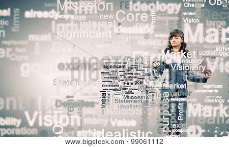 Young businesswoman writing different words on screen