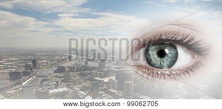 Bird eye view of modern city with human female eye
