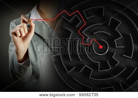 Close up view of businesswoman drawing way in labyrinth