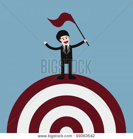 Target With Businessman Holding Flag On Top