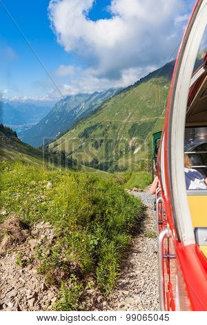 Sightseeing By The Steam Train In Swiss Alps