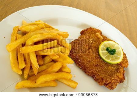 Breaded cutlet with french fries